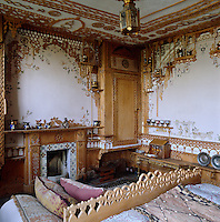 General view of the bedroom showing the extent of the intricate fretwork covering the walls and ceiling