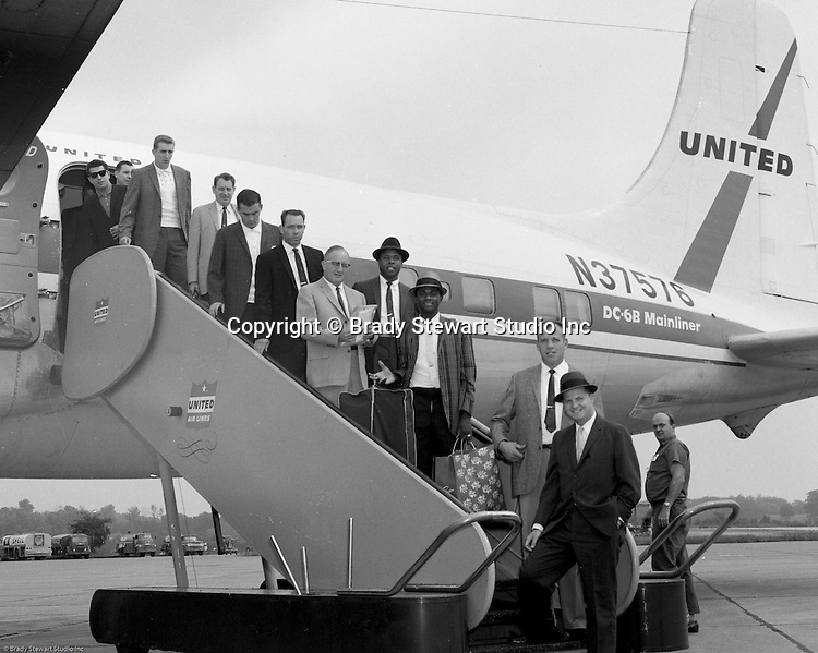 Greater Pittsburgh International Airport:  View of the Cincinnati Reds arriving at the airport for a game with the Pittsburgh Pirates - 1960.  The on location photographic assignment was for United Airlines. The 1960 Cincinnati Reds finished in sixth place in the National League standings, 28 games behind the National League and World Series champion Pittsburgh Pirates!  The highlight for me in this set of images was of the one of Bob Purkey Sr.  I had the opportunity to know Bob Sr while playing high school baseball with his son, Bob Purkey Jr.  For many years, Bob Purkey Sr had a successful insurance business in Bethel Park Pa.