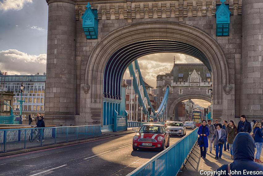 A Mini car crossing Tower Bridge, London.