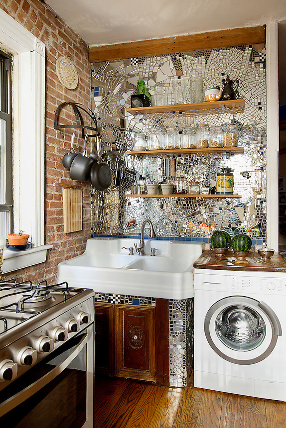 Bright kitchen with exposed brick wall