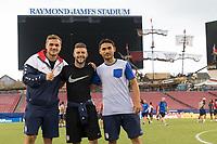 Tampa, FL- Tuesday July 11, 2017: Jordan Morris, Paul Arriola and Cristian Roldan walk the field at Raymond James Stadium.