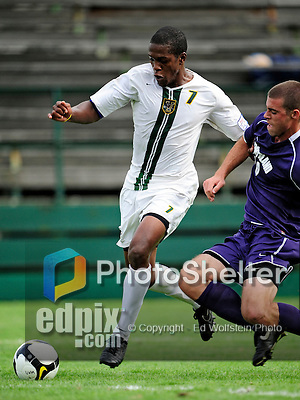 11 September 2009: University of Vermont Catamount forward/midfielder T.J. Gore (7), a Senior from Macomb, MI, battles University of Portland Pilot midfielder Marc Tonkel (10), a Freshman from Los Gatos, CA, in the first round of the 2009 Morgan Stanley Smith Barney Soccer Classic held at Centennial Field in Burlington, Vermont. The Catamounts and Pilots battled to a 1-1 double-overtime tie. Mandatory Photo Credit: Ed Wolfstein Photo