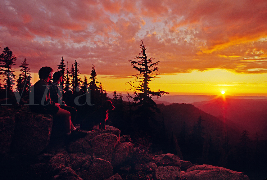 Hikers watch the sunset in the MARBLE MOUNTAIN WILDERNESS - NORTHERN CALIFORNIA