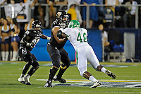 1 September 2011:  FIU offensive lineman Caylin Hauptmann (71) battles North Texas defensive end K.C. Obi (48) at the line in the first half as the FIU Golden Panthers defeated the University of North Texas, 41-16, at FIU Stadium in Miami, Florida.