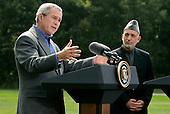 U.S. President George W. Bush and Afghan President Hamid Karzai hold a joint press conference in Camp David Maryland, USA on Monday 06 August 2007. Karzai's two-day visit to the Presidential mountain retreat included discussions of trouble at home, including a hostage crisis and a resurgent Taliban.