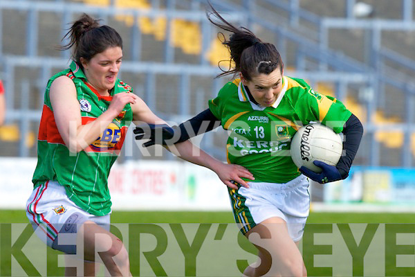 Kerry's Sarah Houlihanshows great determination to go past Mayo's Amy Bell  in the Fitzgerald Stadium on Sunday