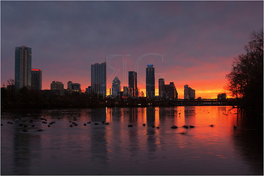 Not many folks are up this early at Zilker Park, but if they are, they are often treated to some wonderful sunrises. This Austin Skyline picture was taken near Lou Neff point. This Austin picture was shot with a long exposure tthat gave the ducks in the water the sense of movement (they were moving and quacking!). In the distance, the sun was just beginning to break through the low layer of clouds that hung over the Austin cityscape. It was a lovely sunrise and a very peaceful morning in central Texas.
