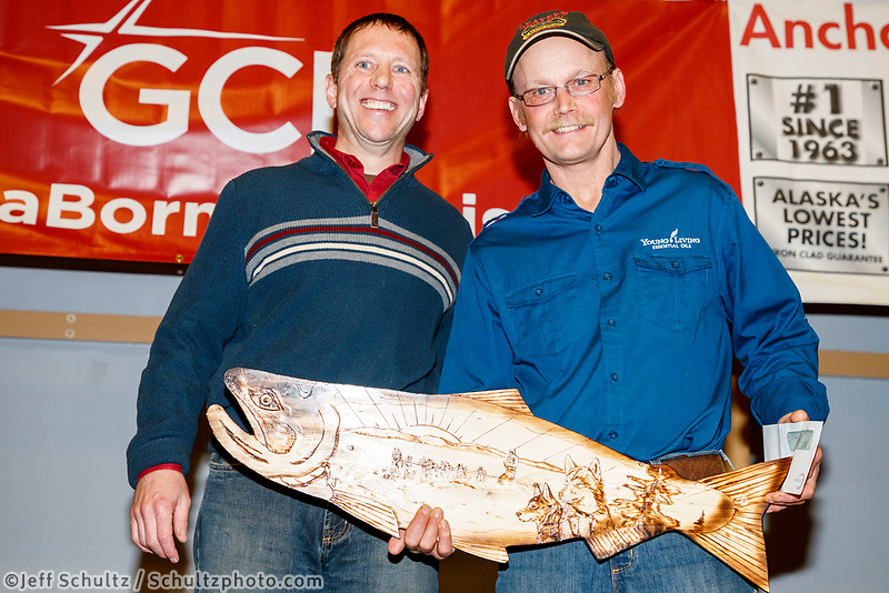 The Bristol Bay Native Corporation Fish First Award is presented by Daniel Chayette, vice president, associate general counsel for Bristol Bay Native Corporation to Mitch Seavey at the Nome Musher's Award Banquet during the 2017 Iditarod on Sunday March 19, 2017.<br /> <br /> Photo by Jeff Schultz/SchultzPhoto.com  (C) 2017  ALL RIGHTS RESERVED
