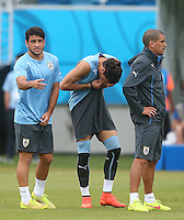 Martin Caceres of Uruguay bites his shorts during training ahead of tomorrow's Group D fixture vs Italy