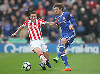 Chelsea's Marcos Alonso battles with Stoke City's Phillip Bardsley<br /> <br /> Photographer Mick Walker/CameraSport<br /> <br /> The Premier League - Stoke City v Chelsea - Saturday 18th March 2017 - bet365 Stadium - Stoke<br /> <br /> World Copyright &copy; 2017 CameraSport. All rights reserved. 43 Linden Ave. Countesthorpe. Leicester. England. LE8 5PG - Tel: +44 (0) 116 277 4147 - admin@camerasport.com - www.camerasport.com