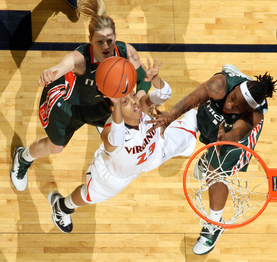 Jan. 6, 2011; Charlottesville, VA, USA; Virginia Cavaliers guard Ataira Franklin (23) shoots between Miami Hurricanes guard Stefanie Yderstrom (3) and Miami Hurricanes guard Riquna Williams (1) during the game at the John Paul Jones Arena. Miami won 82-73. Mandatory Credit: Andrew Shurtleff