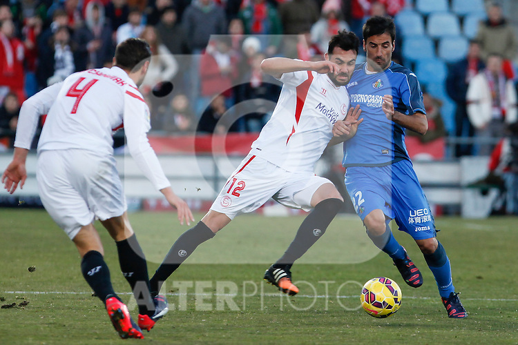 Getafe´s J. Rodriguez (R) and Sevilla´s Iborra during 2014-15 La Liga match at Alfonso Perez Coliseum stadium in Getafe, Spain. February 08, 2015. (ALTERPHOTOS/Victor Blanco)