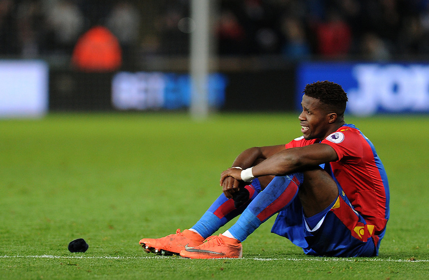 Crystal Palace's Wilfried Zaha left frustrated at full time <br /> <br /> Photographer Ashley Crowden/CameraSport<br /> <br /> The Premier League - Swansea City v Crystal Palace - Saturday 26th November 2016 - Liberty Stadium - Swansea <br /> <br /> World Copyright &copy; 2016 CameraSport. All rights reserved. 43 Linden Ave. Countesthorpe. Leicester. England. LE8 5PG - Tel: +44 (0) 116 277 4147 - admin@camerasport.com - www.camerasport.com