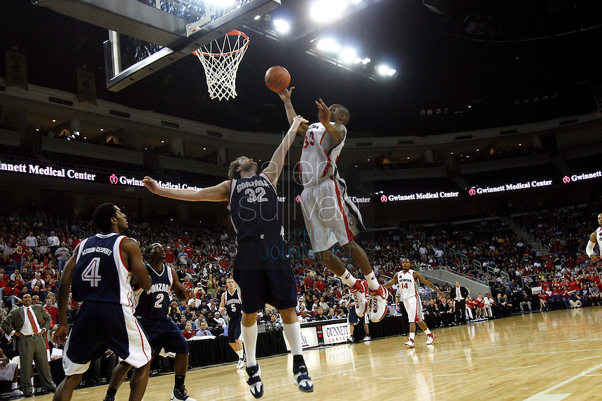 University of Georgia guard Mike Mercer goes up against Gonzaga University forward Sean Mallon in a basketball game against  at The Arena at Gwinnett Center in Duluth, Ga. on Saturday, Dec. 16, 2006. Georgia won 96-83.<br />