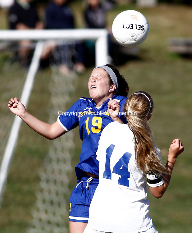 Litchfield, CT- 23 September 2013-092313CM03- Housatonic's Alison Perotti, heads the ball over Litchfield's Hayley McGregor  (14) during Berkshire League girls soccer at Litchfield High School Monday afternoon.  Christopher Massa Republican-American