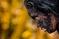 Diana R., who claims to be possessed by spirits, remains covered by black mud after a ritual of exorcism performed by Hermes Cifuentes in La Cumbre, Colombia, 28 May 2012. Exorcism is an ancient religious practice of evicting spirits, generally called demons or evil. Although the formal catholic rite of exorcism is rarely seen and must be only conducted by a designated priest, there are many pastors and preachers in Latin America performing exorcism ceremonies. The 52-year-old Brother Hermes, as the exorcist calls himself, claims to have been carrying out the healing rituals for more than 20 years. Using fire, dirt, candles, flowers, eggs and other natural-based items, in conjunction with Christian religous formulas, he attempts to drive the supposed evil spirit out of a victim's mind and body.