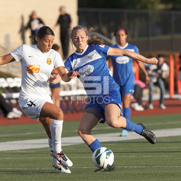 Western New York Flash forward Samantha Kerr (4) and Boston Breakers defender Julie King (8) battle for the ball. In a National Women's Soccer League Elite (NWSL) match, the Boston Breakers (blue) tied Western New York Flash (white), 2-2, at Dilboy Stadium on June 5, 2013.