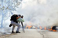 Photographer, Lava flow in the trees and on highway 137, Near Hawaii, USA Volcanoes National Park, Kalapana, Hawaii, USA, The Big Island of Hawaii, USA