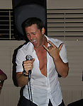 Days Of Our Lives Eric Martsolf sings at SoapFest's Celebrity Weekend - Celebrity Karaoke Bar Bash - autographs, photos, live auction raising money for kids on November 10, 2012 at Bistro Soleil at Old Historic Marco  Island, Florida. (Photo by Sue Coflin/Max Photos)