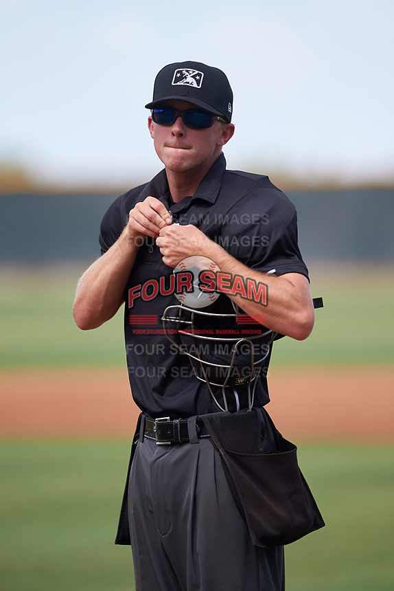 Home plate umpire Bailey Dutten during an Arizona League game between the AZL Indians Red and the AZL Indians Blue on July 7, 2019 at the Cleveland Indians Spring Training Complex in Goodyear, Arizona. The AZL Indians Blue defeated the AZL Indians Red 5-4. (Zachary Lucy/Four Seam Images)