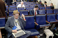 Reporters including Glenn Thrush, chief White House political correspondent for the The New York Times, left, sit in the James S. Brady Press Briefing Room of the White House after being excluded from the meeting  on February 24, 2017 in Washington, DC. CNN, the New York Times and other news organizations were blocked Friday from a White House press briefing. Photo Credit: Olivier Douliery/CNP/AdMedia
