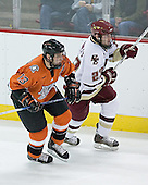 Rich Meloche 13 of Bowling Green and Brian O'Hanley 23 of Boston College head up ice. The Eagles of Boston College defeated the Falcons of Bowling Green State University 5-1 on Saturday, October 21, 2006, at Kelley Rink of Conte Forum in Chestnut Hill, Massachusetts.<br />