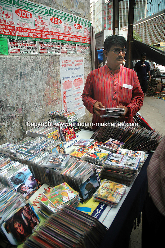 A man buying pirated CD from a street stall in  Kolkata, West Bengal,  India  7/18/2007.  Arindam Mukherjee/Landov