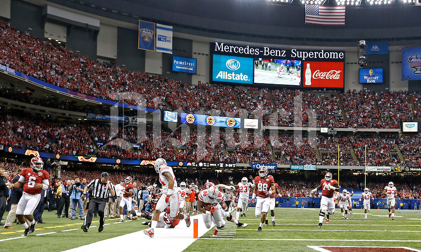 Ohio State Buckeyes defensive lineman Steve Miller (88) returns an interception for a touchdown against Alabama Crimson Tide during the 3rd quarter of the Allstate Sugar Bowl college football Playoff Semifinal game at the Mercedes-Benz Superdome in New Orleans, Louisiana on January 1, 2015.  (Dispatch photo by Kyle Robertson)