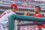 7 October 2016: Washington Nationals pitcher Gio Gonzalez interacts with a young fan prior to the first game of the NLDS against the Los Angeles Dodgers at Nationals Park in Washington, DC. The Dodgers edged out the Nationals 4-3 to take the opening game of their best-of-five series. Mandatory Credit: Ed Wolfstein Photo *** RAW (NEF) Image File Available ***