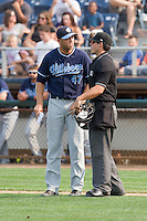 Hillsboro Hops manager Shelley Duncan (47) argues a call with home plate umpire Justin Anderson during a game against the Everett Aquasox at Everett Memorial Stadium in Everett, Washington on July 5, 2015.  Hillsboro defeated Everett 11-4. (Ronnie Allen/Four Seam Images)