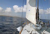 - leisure sailing boat in navigation on the Southern Mediterranean sea ....- barca a vela da diporto in navigazione nel mare Mediterraneo Meridionale