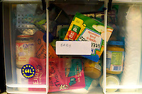 Items of baby food in the store room inside Hammersmith and Fulham food bank in Christ Church, Fulham. Volunteers meet customers, offering a hot drink and cake before an interview is carried out to assess the person's needs. After this specially-selected bags of food are made up. Many food banks are run in or by local churches though not all volunteers at this bank would describe themselves as regular church goers.