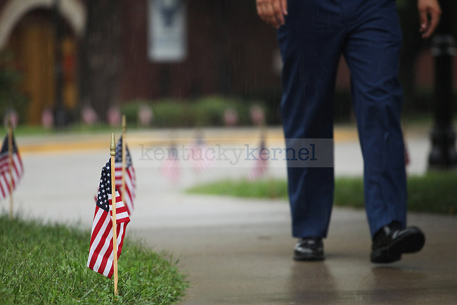 University of Kentucky ROTC participated in a  memorial to honor the victims of Sept. 11, 2001on the front lawn of the Main Building in Lexington, Ky., on Thursday, September 11, 2014. Photo by Tessa Lighty | Staff