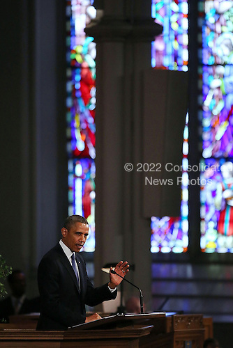 """United States President Barack Obama speaks at an interfaith prayer service for victims of the Boston Marathon attack titled """"Healing Our City,"""" at the Cathedral of the Holy Cross on April 18, 2013 in Boston, Massachusetts. Authorities investigating the attack on the Boston Marathon have shifted their focus to locating the person who placed a black bag down and walked away just before the bombs went off. The twin bombings at the 116-year-old Boston race, which occurred near the marathon finish line, resulted in the deaths of three people and more than 170 others injured.  .Credit: Spencer Platt / Pool via CNP"""