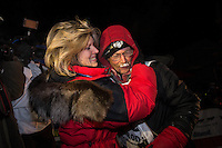Mitch Seavey, right, 53, gets a hug and kiss from his wife, Janine, after pulling into Nome first and winning his second Iditarod seld dog race on Tuesday March 12, 2013. Seavey made the journey from Willow in 9 days, 7 hours, 39 minutes, 56 seconds. ..Iditarod Sled Dog Race 2013..Photo by Jeff Schultz copyright 2013 DO NOT REPRODUCE WITHOUT PERMISSION
