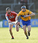 Evan O Siochan of Cork  in action against David Mc Inerney of Clare during their Munster Hurling League game at Cusack Park. Photograph by John Kelly.