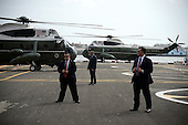 Security detail guard stand near Marine One (on left) carrying United States President Barack Obama and First Lady Michelle Obama before its departure from the Downtown Manhattan/Wall Street Heliport towards JFK Airport in New York New York, on September 29, 2015. <br /> Credit: Anthony Behar / Pool via CNP