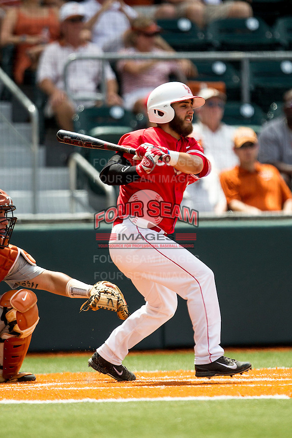 Houston Cougars outfielder Michael Pyeatt (2) follows through on his swing during the NCAA baseball game against the Texas Longhorns on June 6, 2014 at UFCU Disch–Falk Field in Austin, Texas. The Longhorns defeated the Cougars 4-2 in Game 1 of the NCAA Super Regional. (Andrew Woolley/Four Seam Images)
