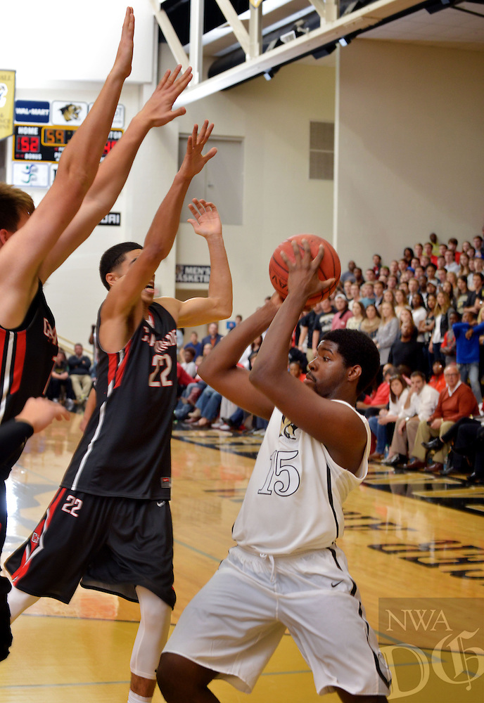 STAFF PHOTO BEN GOFF  @NWABenGoff -- 11/29/14 Tyler Robinson of Bentonville looks to pass while being guarded by Jayson Tatum (22) of St. Louis Chaminade during the game in Bentonville's Tiger Arena on Saturday Nov. 29, 2014.