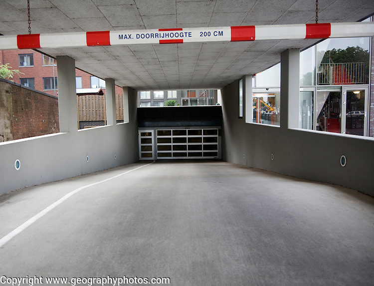 Entrance to parking area of apartments witj height limit restriction barrier Dordrecht, Netherlands,