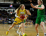 SIOUX FALLS, SD - MARCH 7: Paiton Burckhard #33 of the South Dakota State Jackrabbits drives to the basket against Melissa Leet #5 of the North Dakota Fighting Hawks at the 2020 Summit League Basketball Championship in Sioux Falls, SD. (Photo by Dave Eggen/Inertia)