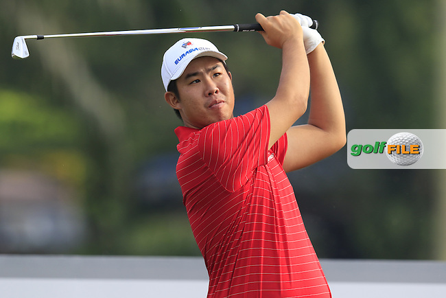 Byeong Hun An (KOR) Team Asia tees off the par3 2nd tee during Match 1 of Friday's Fourball Matches of the 2016 Eurasia Cup presented by DRB-HICOM, held at the Glenmarie Golf &amp; Country Club, Kuala Lumpur, Malaysia. 15th January 2016.<br /> Picture: Eoin Clarke | Golffile<br /> <br /> <br /> <br /> All photos usage must carry mandatory copyright credit (&copy; Golffile | Eoin Clarke)