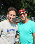 David Granoff (PR) poses with Actor Mark Feuerstein of USA's Royal Pains who played in the Artists vs. Writers 64th Annual Celebrity Softball Game on August 25, 2012 at Herrick Park, East Hampton, New York benefiting East End Hospice, East Hampton Day Care Learning Center, Phoenix Houses of Long Island and The Retreat.  (Photo by Sue Coflin/Max Photos)