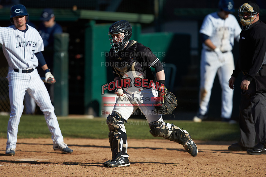West Virginia State Yellow Jackets catcher Austin Roe (21) on defense against the Catawba Indians at Newman Park on February 9, 2020 in Salisbury, North Carolina. The Indians defeated the Yellow Jackets 15-9 in game one of a doubleheader.  (Brian Westerholt/Four Seam Images)