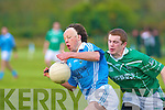 Neil Brendan Foley (Firies) brakes away from Sean Costello (Ballyduff) in last Saturday's game at Farranfore.