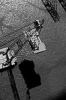 aerial photograph of the Left Coast Lifter heavy duty floating crane lifting a portion of replacement span of San Francisco Oakland Bay Bridge
