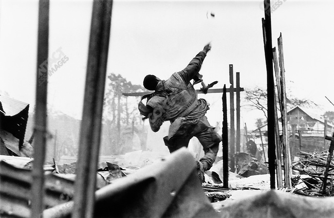 U.S. Marine throwing a hand grenade during the Têt offensive, Battle of Hué, Vietnam, February 1968