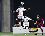 08 July 2007: Gambia's Ousman Jallow (13) challenges Portugal's Paulo Renato (behind) for a header. Gambia's Under-20 Men's National Team defeated Portugal's Under-20 Men's National Team 2-1 in a Group C opening round match at Olympic Stadium in Montreal, Quebec, Canada during the FIFA U-20 World Cup Canada 2007 tournament.
