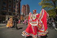 Folk dancers in the Cinco de Mayo Parade in New York on Sunday, May 5, 2013. The holiday commemorates a victory of Mexican forces led by General Ignacio Zaragoza Seguín over French forces in the Battle of Puebla on May 5, 1862. In the United States Mexican-Americans celebrate with parades and festivals as a show of ethnic pride.  (© Richard B. Levine)