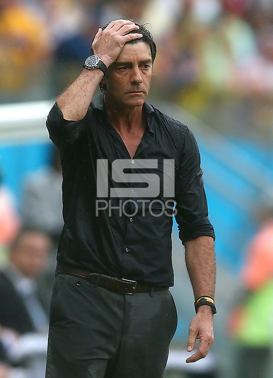 A soaking wet Germany coach Joachim Loew on the touchline